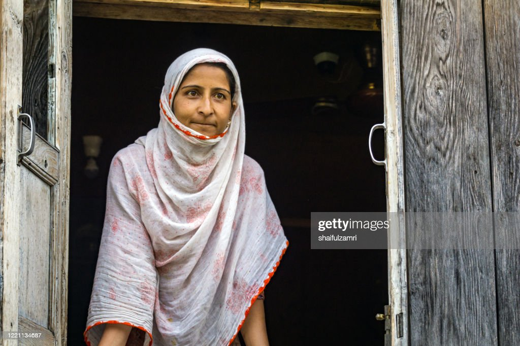 Kashmiri lady look out from window. : Stock Photo
