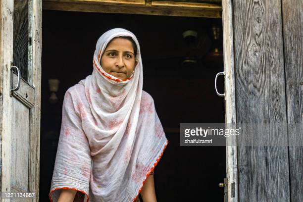 kashmiri lady look out from window. - shaifulzamri stock pictures, royalty-free photos & images