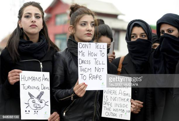 Kashmiri law students hold placards during a protest calling for justice following the rape and murder of an eightyearold girl in the Indian state of...