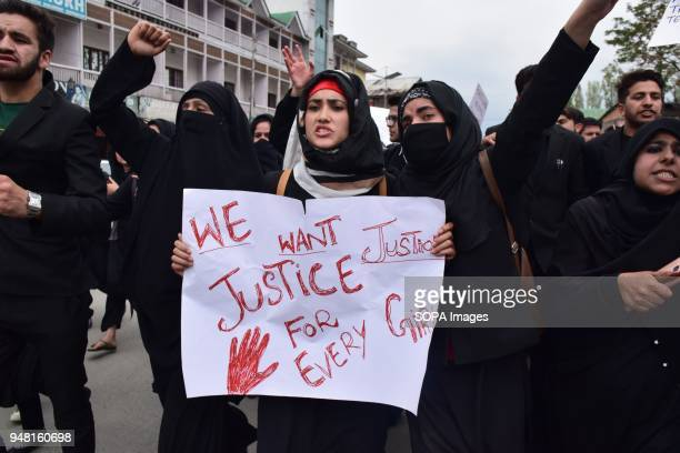 SRINAGAR KASHMIR INDIA SRINAGAR JAMMU KASHMIR INDIA Kashmiri locals and students hold placards during demonstration held in Srinagar summer capital...