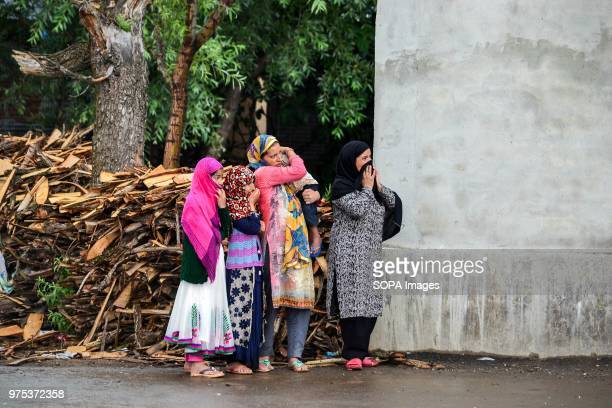 Kashmiri locals watch the funeral procession of Shujaat Bukhari veteran journalist and EditorinChief of English daily 'Rising Kashmir' in Kreeri some...