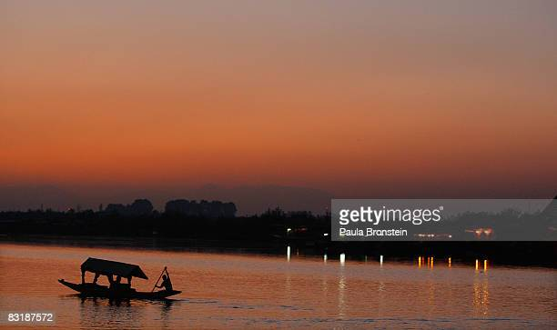 Kashmiri man paddles his boat at sunset on Dal Lake October 7, 2008 in Srinagar, Kashmir. In the past few months the region's summer captiol has...