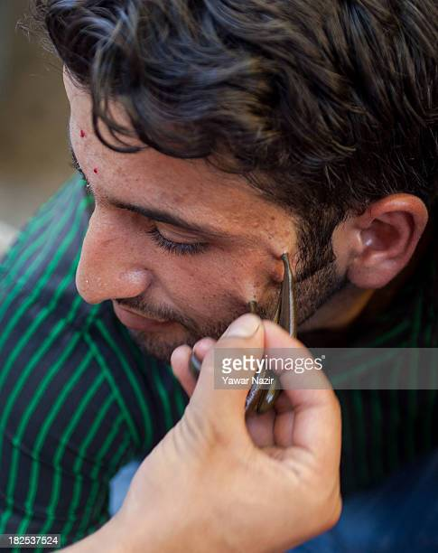 A Kashmiri man receives leech therapy on September 30 2013 in Srinagar the summer capital of Indian administered Kashmir India Practitioners of the...