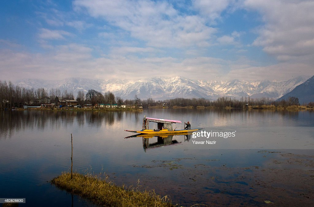 A Kashmiri man rows his shikara boat on the waters of Dal lake on February 06, 2015 in Srinagar, the summer capital of Indian administered Kashmir State, India. The Dal Lake in Kashmir is integral to tourism and recreation for tourists, authorities are planning to shift some families living in the inner part of the water body to protect the Dal Lake, which is shrinking due to pollution. Authorities say pollution from houseboats is one of the factors threatening the survival of the Dal Lake. During the summer tourist season roughly 100,000 liters of sewage from houseboats spews into the lake, feeding weeds and choking the lake and its aquatic life of oxygen, Local officials said. Dal Lake, one of the region's key tourist attractions, has shrunk from 25 sq km to 13 sq km since the 1980s due to pollution over decades of neglect and a separatist revolt, according to environmental activists.