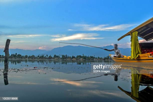 Kashmiri man seen fishing on Dal the lake Daily life on the waters of Dal Lake in Srinagar Indian administered Kashmir