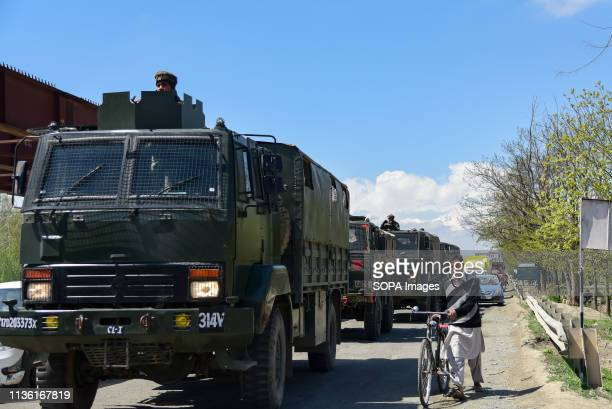Kashmiri man seen walking with his bicycle next to army convoys on National Highway on the outskirts of Srinagar The Indian authorities on Wednesday...