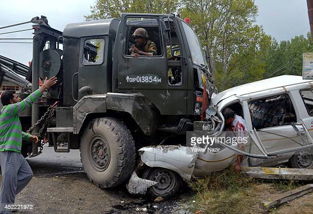 A Kashmiri man shouts at the driver of an Indian Army vehicle after it rammed into a cab killing at least six people July 16 2014 in Zaina Koot on...