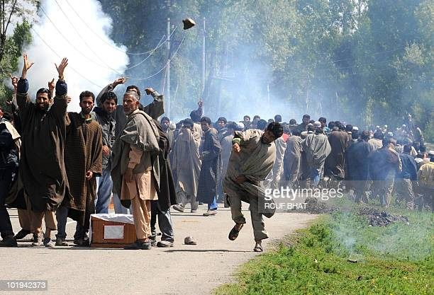 A Kashmiri man throws stones at police during the funeral procession for three civilians in Rafiabad in northern Baramulla district on May 29 2010...