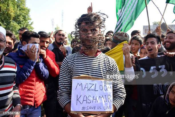 A Kashmiri man wearing concertina wire around his face to protest the ongoing blockade after Friday prayers in Srinagar Indian Administered Kashmir...