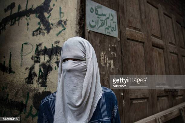 A Kashmiri masked protestor looks upon during funeral of a local rebel Sajad Gilkar Wednesday July 12 2017 in Srinagar Indianadministered Kashmir...