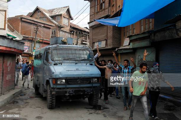 Kashmiri Men defy curfew as they march carrying the the body of local proindependence fighter Sajad Ahmed Gilkar during his funeral procession in old...