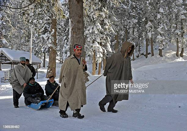 Kashmiri men pull sleighs carrying Indian tourists in Gulmarg, situated about 55 kms north of Srinagar, on January 13, 2012. Gulmarg is the main ski...