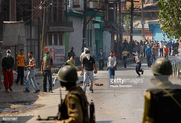 Kashmiri men throw rocks at Indian military while tensions on the streets remain high October 12 2008 in Srinagar Kashmir India Violence remains a...