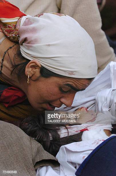 Kashmiri mother kisses the body of her daughter after an attack in southern Pulwama district Tahab villageabout 40kms south of Srinagar 10 November...
