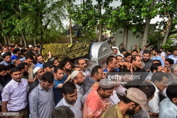 Kashmiri mourners carry the coffin of Shujaat Bukhari veteran journalist and EditorinChief of English daily 'Rising Kashmir' in Kreeri some 45kms...