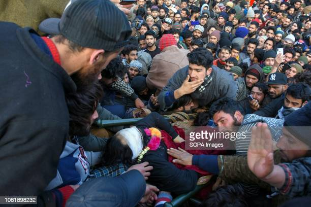 Kashmiri mourners seen gathered near the body of Zeenat ul Islam during his funeral procession in Shopian about 60kms south of Srinagar Indian...