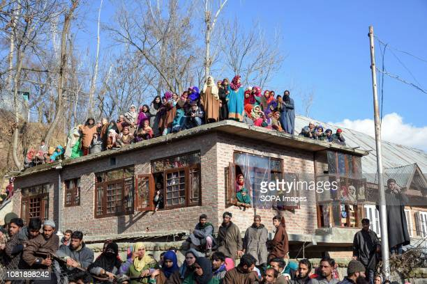 Kashmiri mourners seen watching the funeral procession of Zeenat ul Islam in Shopian about 60 kms south of Srinagar Indian administered Kashmir...