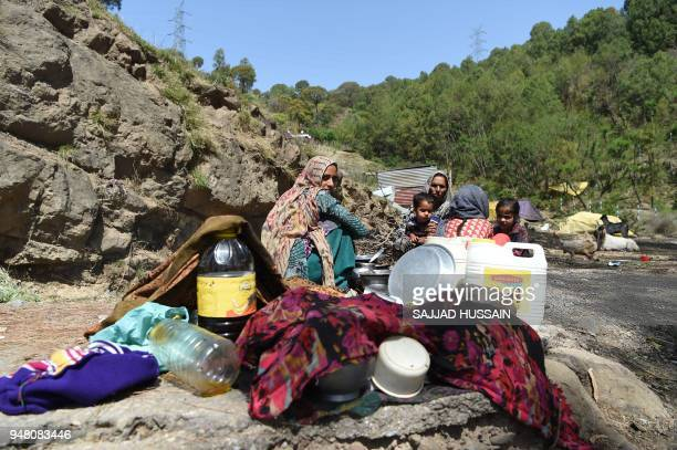 A Kashmiri Muslim Bakarwal nomad family prepare food at a temporary camp near Udhampur some 72 kms north of Jammu on April 18 2018 Nationwide...