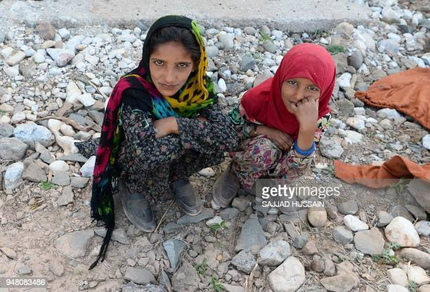 Kashmiri Muslim Bakarwal nomad girls rest at a temporary camp near Udhampur some 72 kms north of Jammu on April 18 2018 Nationwide protests have been...