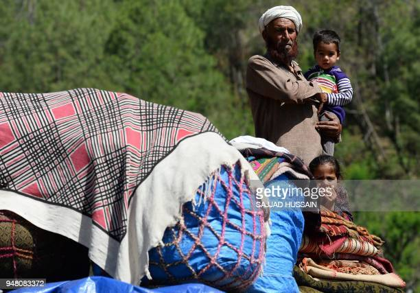 A Kashmiri Muslim Bakarwal nomad holds his grandson at a temporary camp near Udhampur some 72 kms north of Jammu on April 18 2018 Nationwide protests...