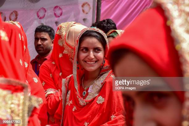SONWAR SRINAGAR JAMMU KASHMIR INDIA Kashmiri Muslim brides reacts during mass marriage event in Srinagar Indian controlled Kashmir on Sunday Mass...
