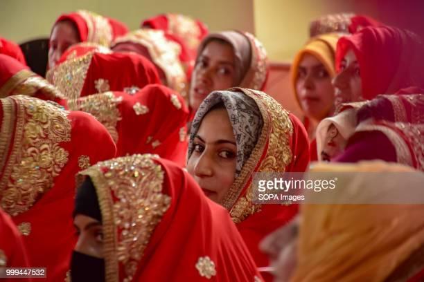 SONWAR SRINAGAR JAMMU KASHMIR INDIA Kashmiri Muslim brides sit for a mass marriage event in Srinagar Indian controlled Kashmir on Sunday Mass wedding...