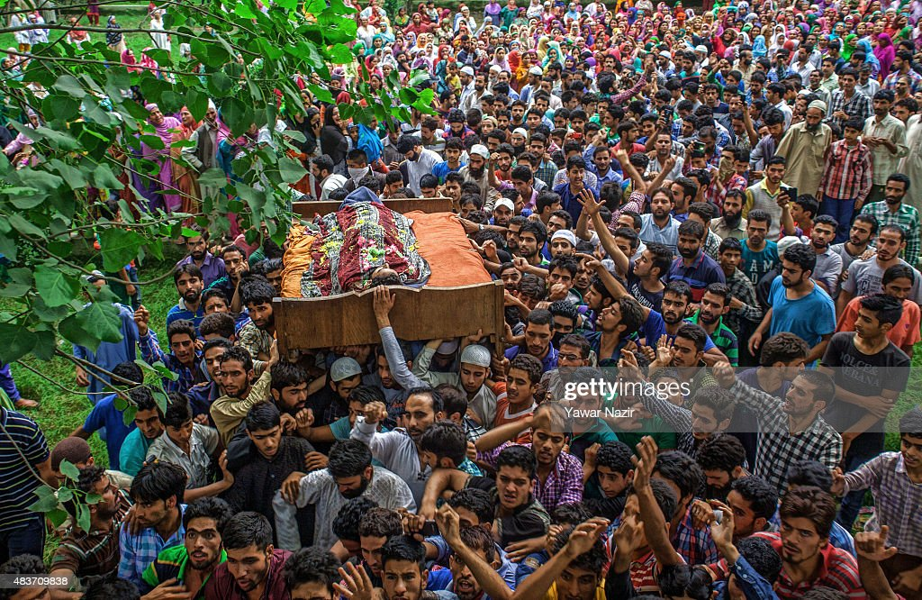Kashmiri Muslim carry the body of Bilal Ahmad Bhat, 23, a civilian who was allegedly shot dead by Indian paramilitary Border Security Force (BSF) during his funeral on August 12, 2015 in Larkipur, 35 km (21 miles) south of Srinagar, the summer capital of Indian administered Kashmir, India. Hundreds of Kashmiris participated in the funeral of Bhat who was killed by the Indian paramilitary BSF after they allegedly opened fire on the protestors who were protesting against the killing of two Lashkar-e-Taiba (Army of the Righteous), one of the largest and most active militant organization operating in Indian administered Kashmir, militants in an gun battle in Rakh-e-Lajura village of south Kashmir district on 11 August 2015.