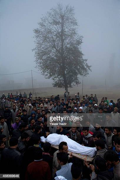 Kashmiri Muslim carry the body of MehrajudDin Dar a civilian killed by Indian army during his funeral on November 04 2014 in Srinagar the summer...