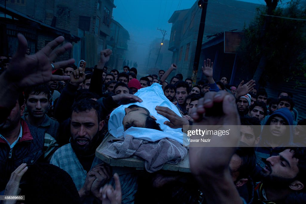Kashmiri Muslim carry the body of Mehraj-ud-Din Dar (27), a civilian killed by Indian army, during his funeral on November 04, 2014 in Srinagar, the summer capital of Indian administered Kashmir, India. Indian government Tuesday imposed a stringent curfew in most parts of Srinagar after Indian army killed two civilians and wounded two others on Monday. The troopers of Indian army's 53 Rashtriya Rifles while trying to stop a vehicle during a checking at the main market in Chattergam last evening had shot at the car after it allegedly didn't stop. In the incident, four persons who were travelling in the vehicle sustained critical bullet wounds and two died. Stone-pelting clashes also broke out at many areas in its adjoining area, reports said on Monday, Indian forces used tear gas shells and opened volley of shots in air to disperse the protesting youth.