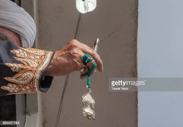 Kashmiri Muslim cleric displays the holy relic believed to be the whisker from the beard of the Prophet Mohammed at Hazratbal shrine to mark the...