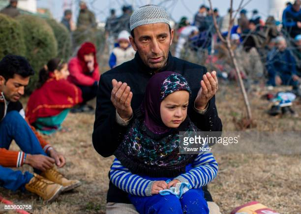 Kashmiri Muslim devotee pray at Hazratbal shrine on the EideMilad or the birth anniversary of Prophet Mohammad on December 1 2017 in Srinagar the...