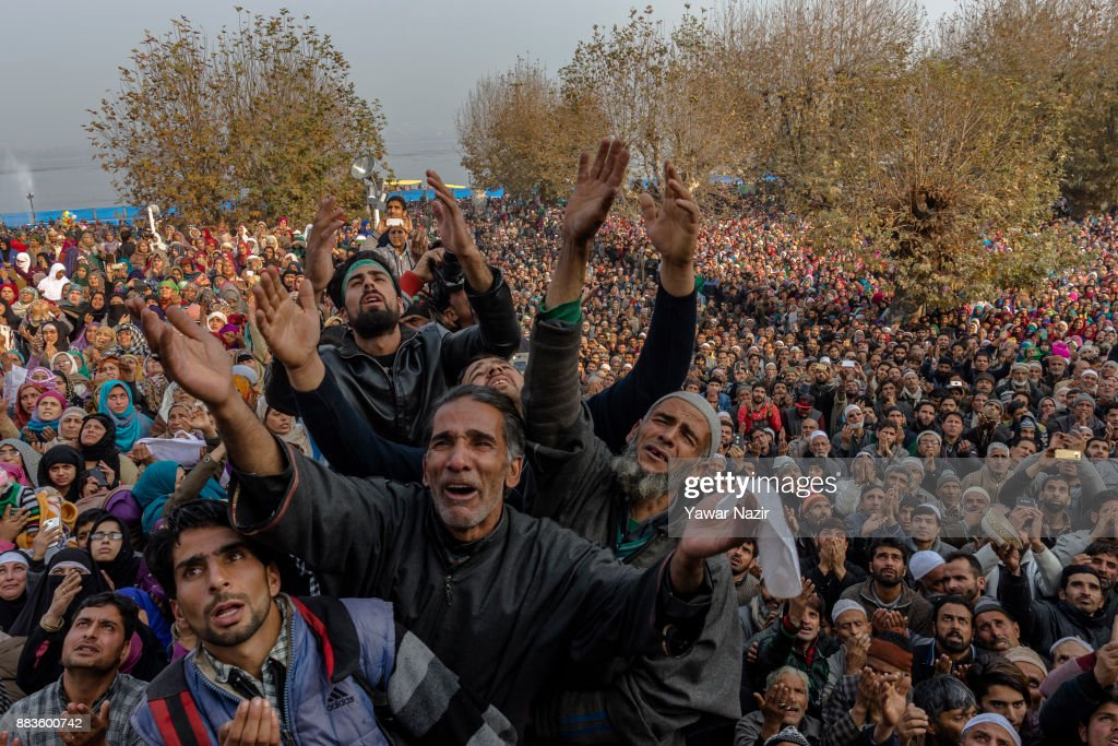 Kashmiri Muslim devotees look towards a cleric (not seen in the picture) displaying the holy relic believed to be the whisker from the beard of the Prophet Mohammed, at Hazratbal shrine on the Eid-e-Milad , or the birth anniversary of Prophet Mohammad on December 1, 2017 in Srinagar, the summer capital of Indian administered Kashmir, India. Hundreds of thousands of Muslims from all over Kashmir visit the Hazratbal shrine in Srinagar to pay obeisance on the Eid-e-Milad , or the birth anniversary of Prophet Mohammed. The shrine is highly revered by Kashmiri Muslims as it is believed to house a holy relic of the Prophet Mohammed. The relic is displayed to the devotees on important Islamic days such as the Eid- Milad when Muslims worldwide celebrate.