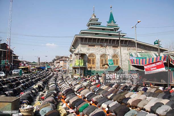 Kashmiri Muslim devotees offer prayer outside the shrine of Sufi Saint Syed Abdul Qadir Jilani on February 12 2014 in Srinagar India Thousands of...