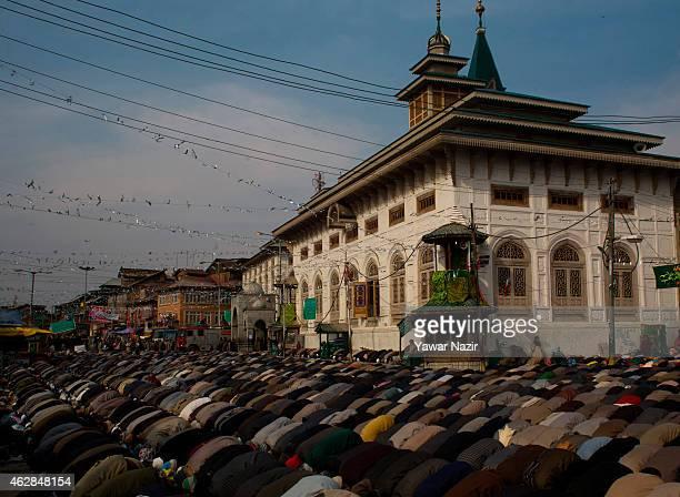 Kashmiri Muslim devotees offer prayers outside the Dastgeer Sahib shrine on the Friday following the annual Urs on February 06 2015 in Srinagar the...