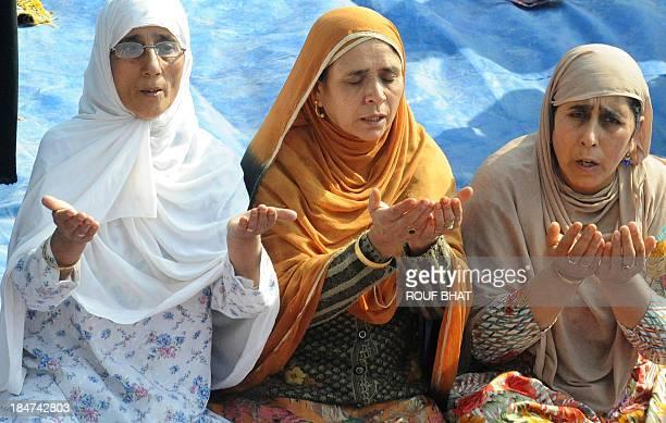 Kashmiri Muslim devotees perform Eid alAdha prayers at Hazratbal shrine in Srinagar on October 162013 Muslims across the world are celebrating the...