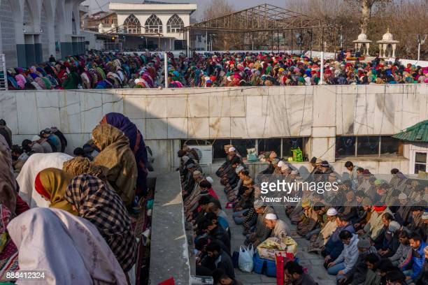 Kashmiri Muslim devotees pray at Hazratbal shrine on the Friday following EideMilad or the birth anniversary of Prophet Mohammad on December 8 2017...