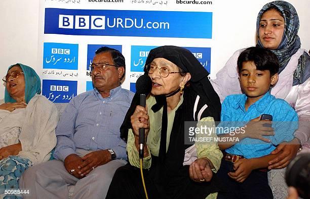 Kashmiri muslim family talk with relatives inside a studio in Srinagar 23 June 2004 where the British Broadcasting Corporation had arranged a webcam...