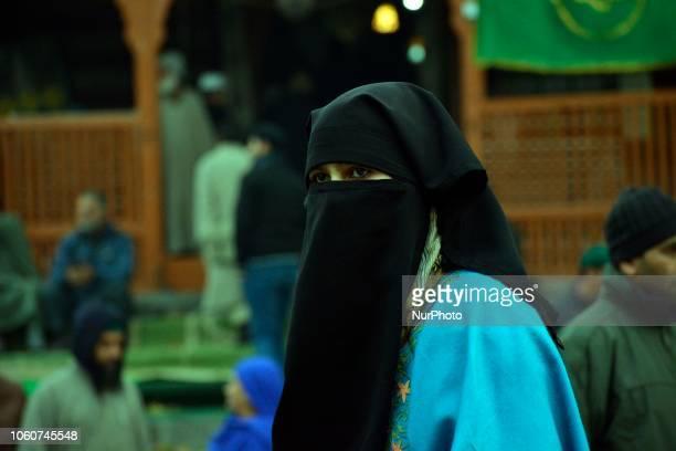 A Kashmiri Muslim girl pray after the special congregational Asar prayers Known as 'Khoje Diger' at the shrine of Hazart Syed Khawaja Nasqshband at...