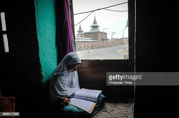 Kashmiri Muslim girl studies at her home in downtown area on August 11 2016 in Srinagar India As the Kashmir Valley continues to witness curfew...