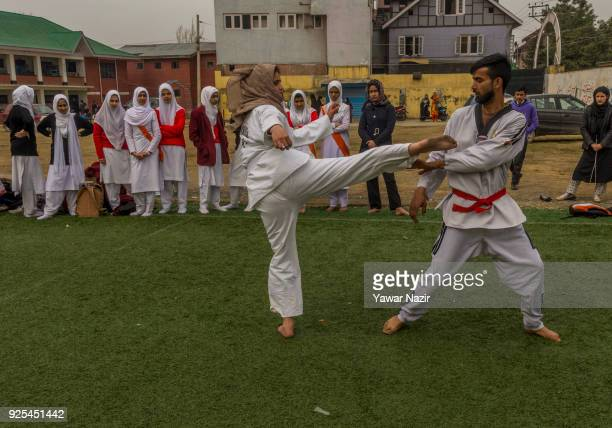 Kashmiri Muslim girls learn martial arts from a coach in the courtyard of a school on February 28 2018 in Srinagar the summer capital of Indian...