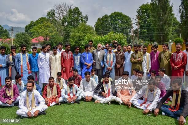 SONWAR SRINAGAR JAMMU KASHMIR INDIA Kashmiri Muslim grooms sit for a group photo during mass marriage event in Srinagar Indian controlled Kashmir on...
