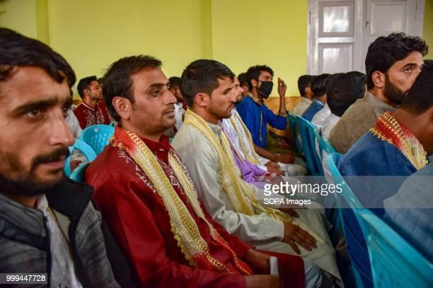 SONWAR SRINAGAR JAMMU KASHMIR INDIA Kashmiri Muslim grooms sit for a mass marriage event in Srinagar Indian controlled Kashmir on Sunday Mass wedding...