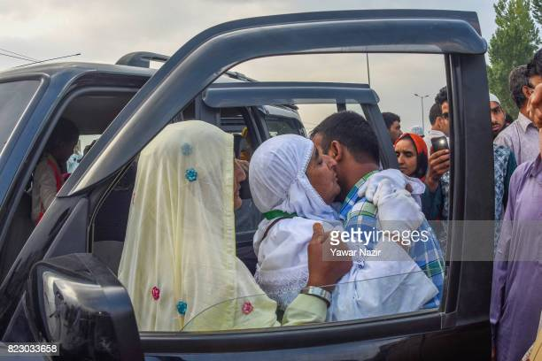 Kashmiri Muslim hajj pilgrim greets her son before departing for the annual Hajj pilgrimage to Mecca on July 26 2017 in Srinagar the summer capital...
