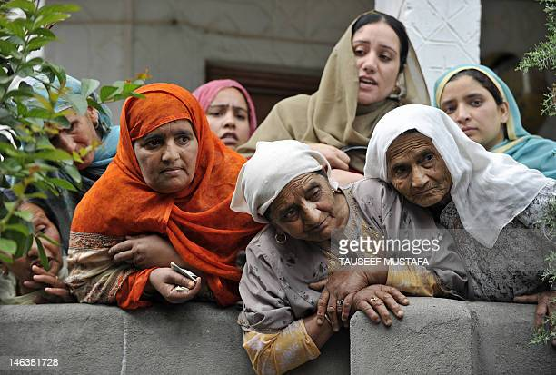 Kashmiri Muslim look on during a funeral of ruling party National Conference Block President Abdul Rehman Ganaie in Srinagar on June 15,2012....