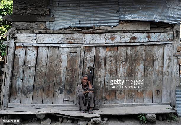 Kashmiri Muslim looks on during the annual Hindu festival at the Khirbhawani temple in Tullamulla village some 30kms east of Srinagar on June 12 2016...