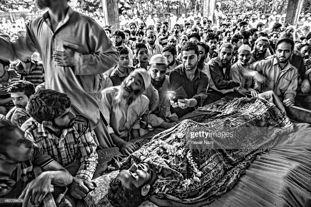 Kashmiri Muslim mourn over the body of Bilal Ahmad Bhat, 23, a civilian who was allegedly shot dead by Indian paramilitary Border Security Force (BSF) during his funeral on August 12, 2015 in Larkipur, 35 km (21 miles) south of Srinagar, the summer capital of Indian administered Kashmir, India. Hundreds of Kashmiris participated in the funeral of Bhat who was killed by the Indian paramilitary BSF after they allegedly opened fire on the protestors who were protesting against the killing of two Lashkar-e-Taiba (Army of the Righteous), one of the largest and most active militant organization operating in Indian administered Kashmir, militants in an gun battle in Rakh-e-Lajura village of south Kashmir district on 11 August 2015.
