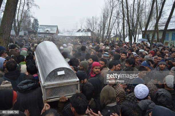Kashmiri Muslim people carry a coffin during the funeral procession of Hizb Rebel Mushtaq Ahmad seen at his native village Malangam Mushtaq was...