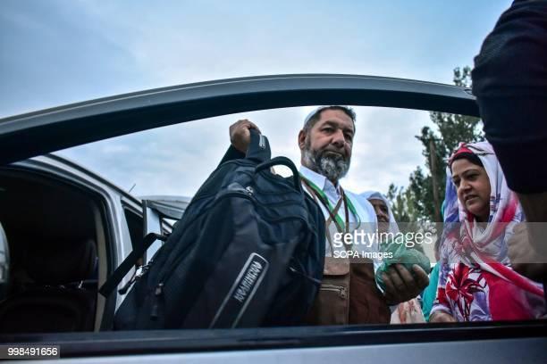 Kashmiri Muslim pilgrim arrives at The State Hajj House in Srinagar Indian administered Kashmir The first batch of 820 Kashmiri pilgrims set off for...