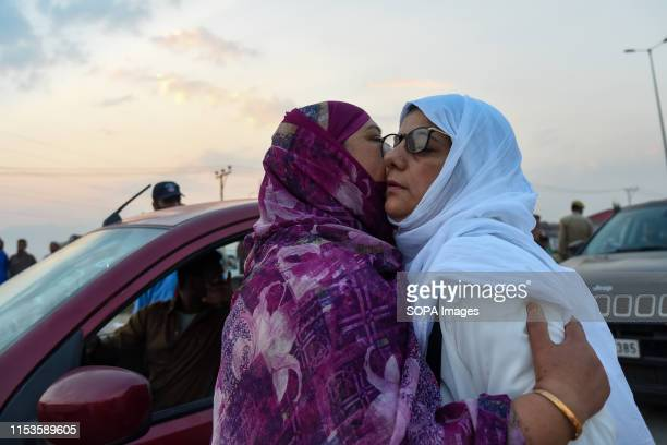 Kashmiri Muslim pilgrim is being hugged by her relative before departure to annual Hajj pilgrimage to Mecca in Srinagar The first batch of 304...
