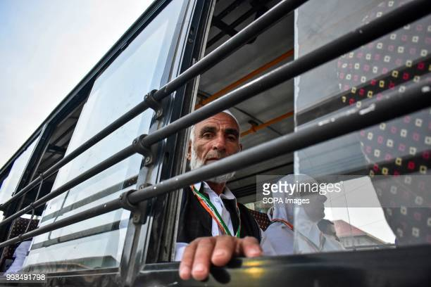 Kashmiri Muslim pilgrim looks on as he leaves for the annual hajj pilgrimage to the holy city of Mecca in Srinagar Indian administered Kashmir The...